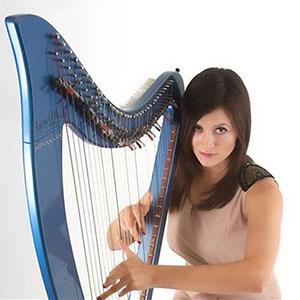 Female playing blue harp | ChurchMusic.ie